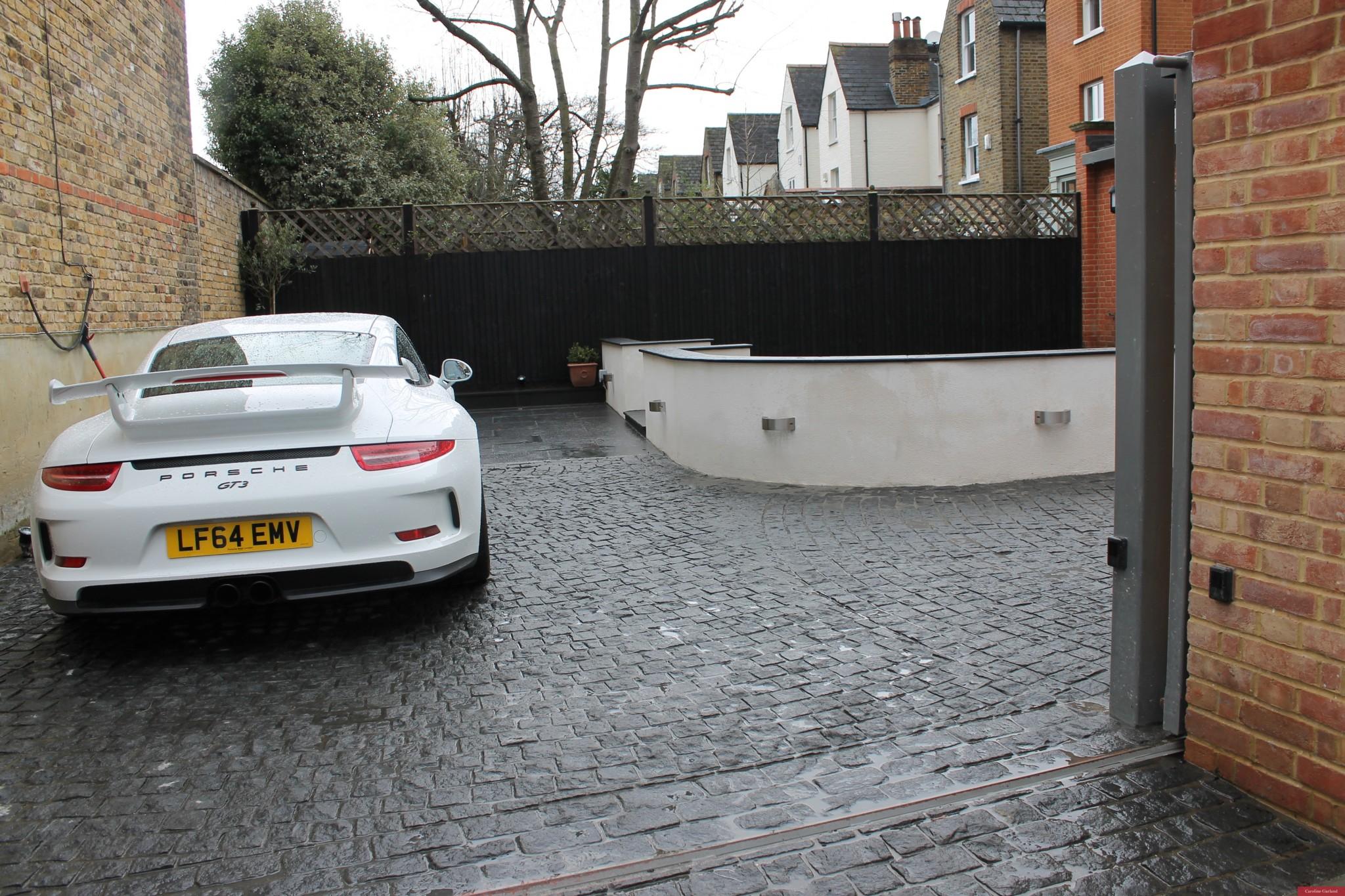 Black fence, black drive Clapham