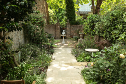 Path leading to seating area at the bottom of the garden