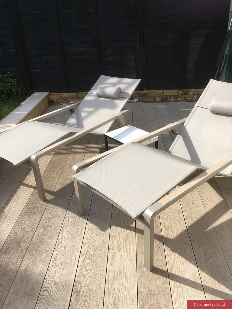 Sun loungers on composite decking